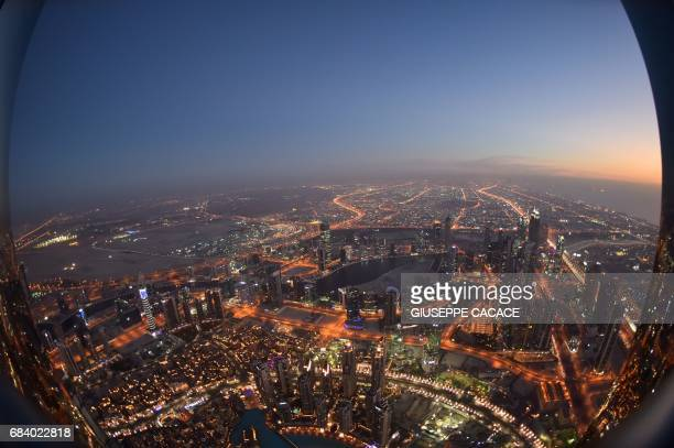 TOPSHOT The skyline of Dubai is pictured from the Burj Khalifa the tallest building in the world standing at 828 metres on May 16 2017 / AFP PHOTO /...