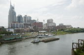The skyline of Nashville is seen with riverfront concert stage and midway during the 2004 CMA Music Festival formerly known as FanFair June 10 2004...