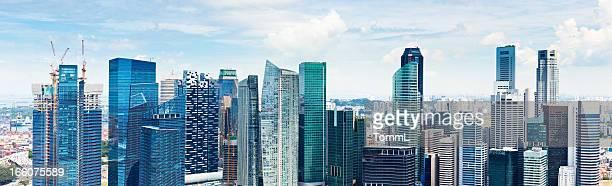 The skyline of Singapore as the sun breaks through.