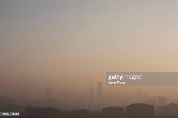 The skyline of the city can be seen under severe smog and pollution before it cleared on December 10 2015 in Beijing China The Beijing government...