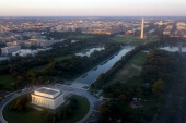 The skyline of Washington DC including the Lincoln Memorial Washington Monument US Capitol and National Mall is seen from the air at sunset in this...