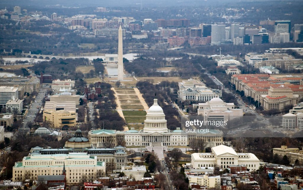 The skyline of Washington DC including the US Capitol building Washington Monument Lincoln Memorial and National Mall is seen from the air January 29...