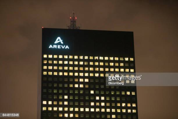 The skyscraper headquarter offices of Areva SA stand illuminated at night in La Defense business district in Paris France on Thursday Feb 23 2017...