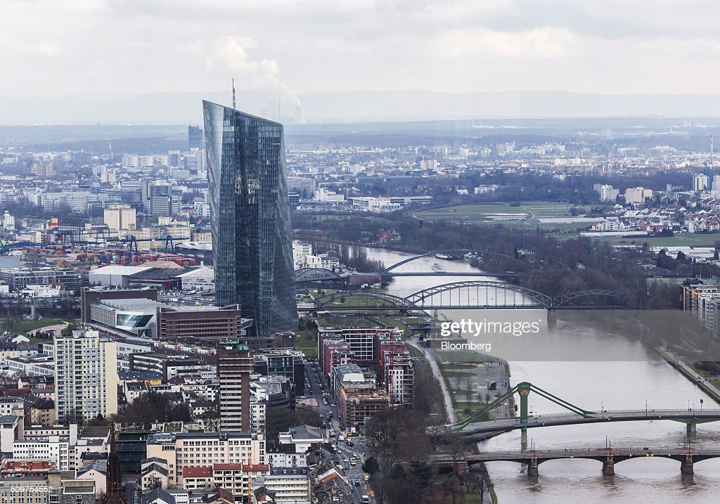 The skyscraper headquarter offices of the European Central Bank (ECB) stand on the River Main, as seen from the headquarters of Commerzbank AG in Frankfurt, Germany on Friday, Feb. 12, 2016. Commerzbank jumped the most in more than two years after fourth-quarter profit beat analyst estimates, as the lender said it plans to wind down its unit for soured loans at a faster pace than forecast. Photographer: Martin Leissl/Bloomberg via Getty Images