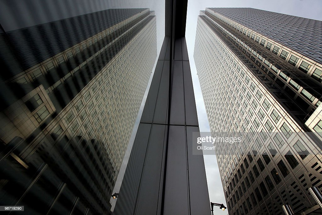 The skyscraper 'One Canada Square' is reflected in an adjacent building in Canary Wharf on February 15 2010 in London England As the UK gears up for...