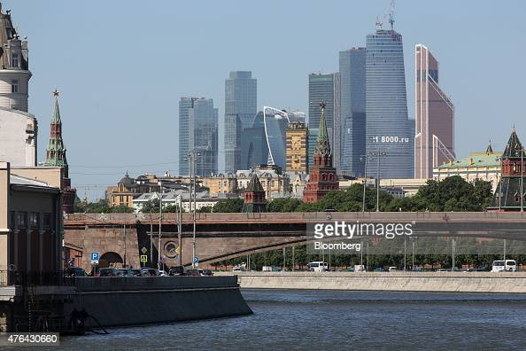 The skyscrapers of Moscow City business district center stand on the horizon beyond the Kremlin right on the banks of the Moscow river in Moscow...