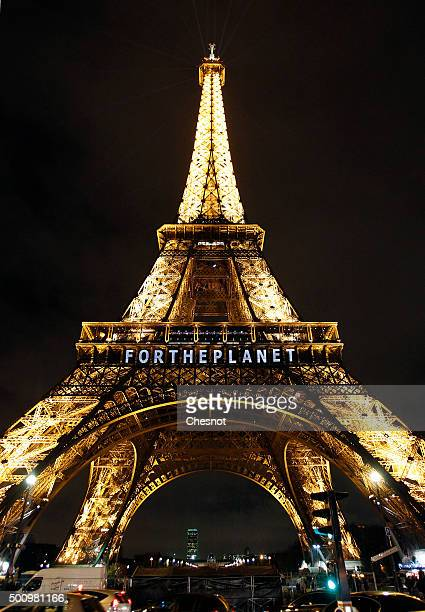 The slogan 'For the planet' is projected on the Eiffel Tower as part of the World Climate Change Conference 2015 on December 11 2015 in Paris France...