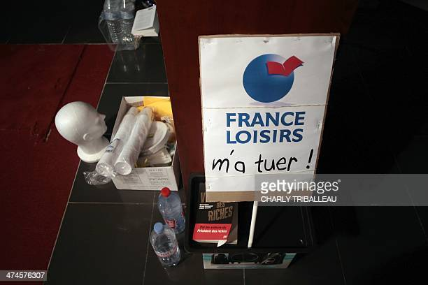 The slogan 'killed me ' added to the name of France Loisirs group by an employee is seen early on February 24 2014 in a shop of 'Chapitre' book...