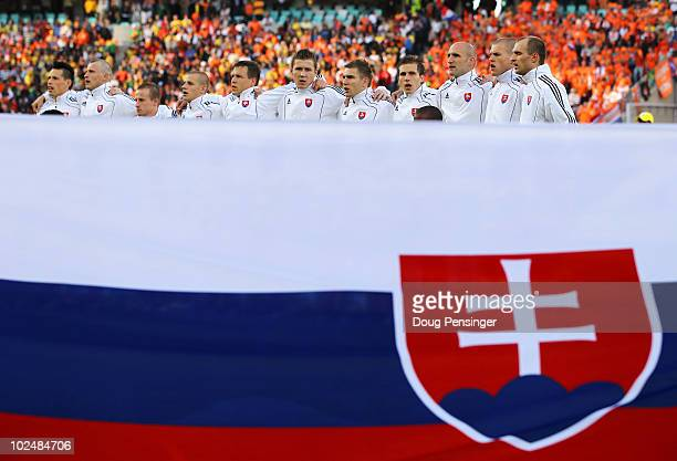 The Slovakia team line up for the national anthems prior to the 2010 FIFA World Cup South Africa Round of Sixteen match between Netherlands and...