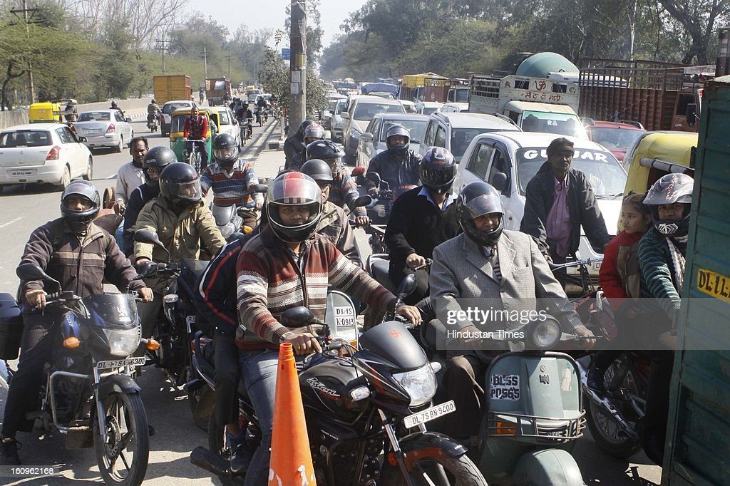 The slow moving Traffic as the pantoon bridge adjacent to Wazirabad bridge was swayed away by the water released suddenly from the Hathni Kund Bairaj ,Harayna, At Wazirabad Bridge on February 8, 2013 in New Delhi, India.