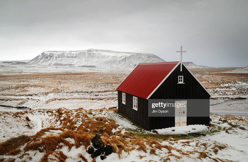 The small church of Krysuvikurkirkja sits in isolation in the snow covered region of the Reykjanes Peninsula on February 19, 2009 in the south west of Iceland. A country of glacial and volcanic geology, with a rich historic tradtion, Iceland was ranked in 2007 by the UNHDI as the most developed nation in the world. In 2008 Iceland was hit especially hard by the global economic slowdown, the debts of it's banks were six times the country's annual GDP.