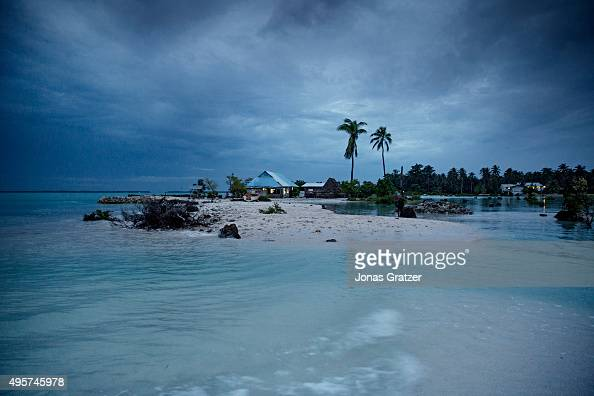 The small village Eita has become a separate island during high tide The people of Kiribati are under pressure to relocate due to sea level rise Each...