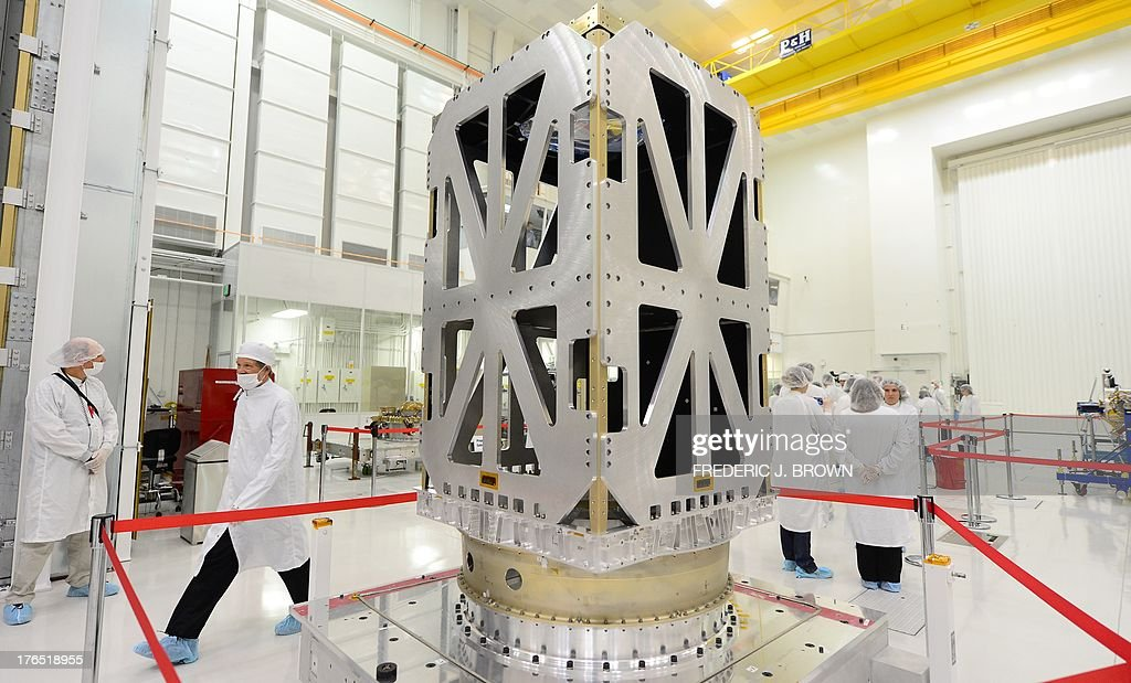 The SMAP spacecraft is cordoned off inside the Spacecraft Assembly Facility Cleanroom at the Jet Propulsion Laboratory in Pasadena, California on August 13, 2013, where NASA Administrator Charles Bolden came to view the progress and assembly of the Soil Moisture Active Passive (SMAP) satellite presently under construction and due to launch in October 2014. SMAP will produce global maps of soil moisture for tracking water availability around the planet, and will also detect winter freeze and spring thaw to track changes in growing season patterns, allowing scientists to determine how much carbon plants take up from the atmosphere each year. AFP PHOTO/Frederic J. BROWN