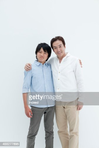 The smiling face of father and son