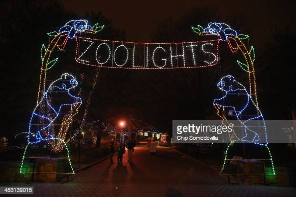 The Smithsonian National Zoological Park's entrance is decorated with holiday lights during the ZooLights celebration December 2 2013 in Washington...