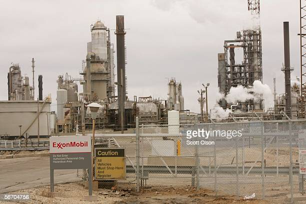 The smoke and steam billows from the stacks at the Exxon Mobil Corp refinery January 30 2006 in Joliet Illinois Exxon Mobil posted a record $1071...