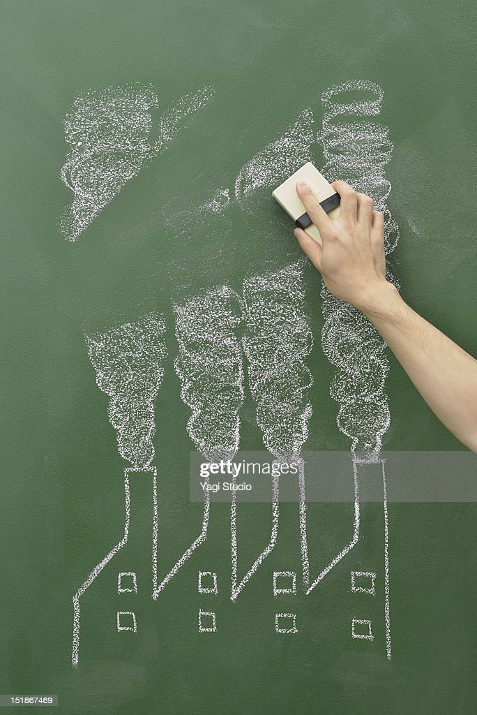 The smoke of a factory drawn on the blackboard and : Stock Photo
