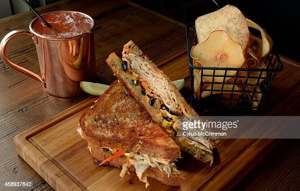 The smoked chicken pastrami sandwich with grilled rye swiss cheese and spicy southwestern slaw at the Chop Shop at 4990 E Colfax Ave in Denver The...