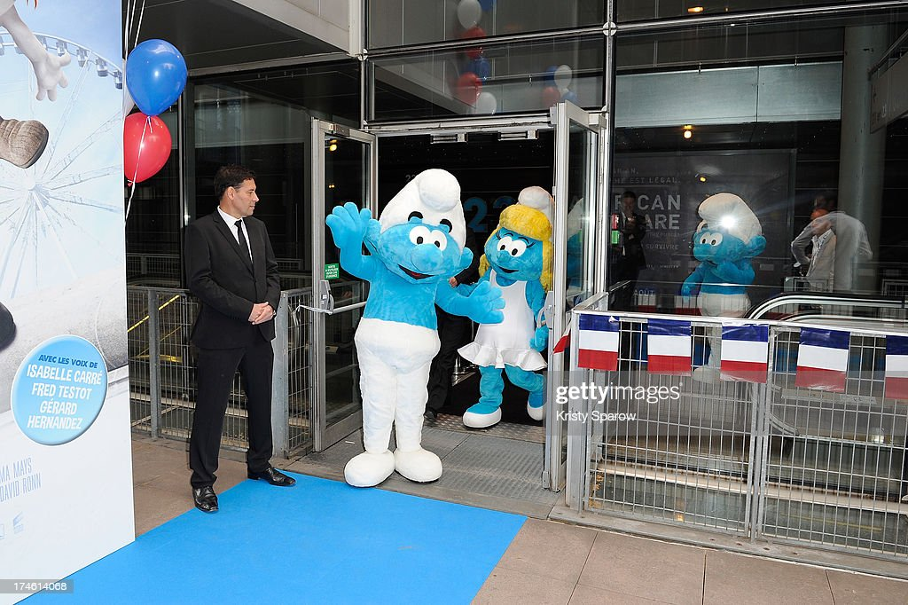 The Smurfs in costume arrive to the 'Smurfs 2' Paris Premiere at UGC Cine Cite Bercy on July 28, 2013 in Paris, France.
