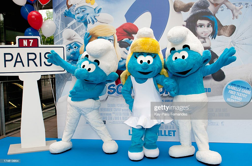 The Smurfs in costume pose for photos at the 'Smurfs 2' Paris Premiere at UGC Cine Cite Bercy on July 28, 2013 in Paris, France.