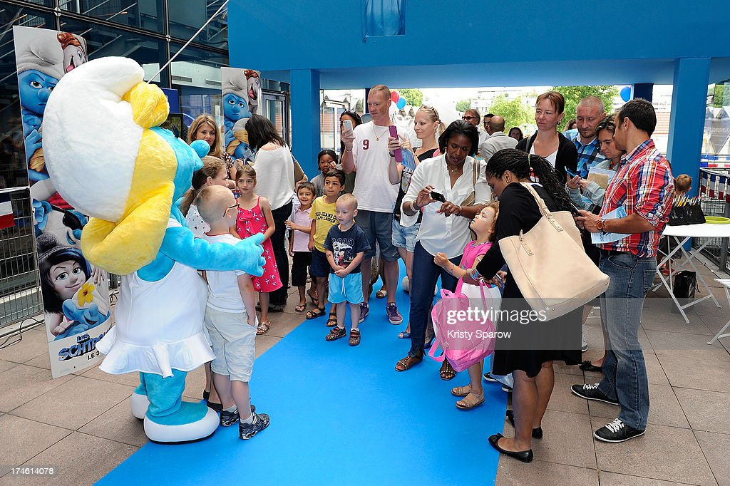 The Smurfs in costume pose with young fans during the 'Smurfs 2' Paris Premiere at UGC Cine Cite Bercy on July 28, 2013 in Paris, France.