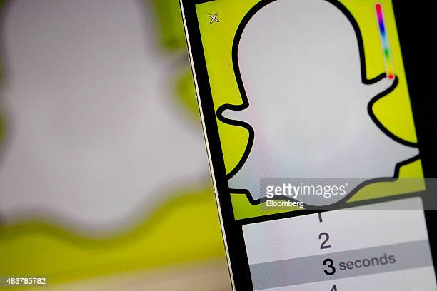 The Snapchat Inc application is displayed for a photograph on an Apple Inc iPhone 5s in Washington DC US on Wednesday Feb 18 2015 Snapchat Inc is...
