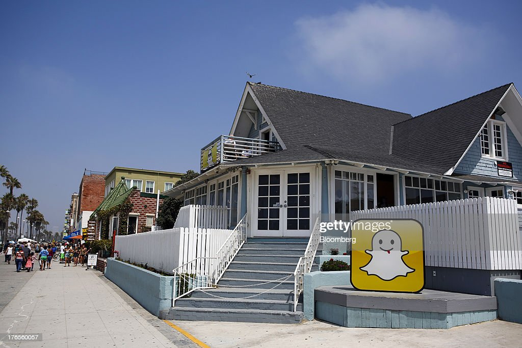 The Snapchat Inc. logo stands outside the company's headquarters on the strand at Venice Beach in Los Angeles, California, U.S., on Wednesday, Aug. 14, 2013. Snapchat is a photo and video sharing application that allows the user to pre-set a period of time, no more than ten seconds, for the receiver to view the content before it disappears from the screen. Photographer: Patrick Fallon/Bloomberg via Getty Images