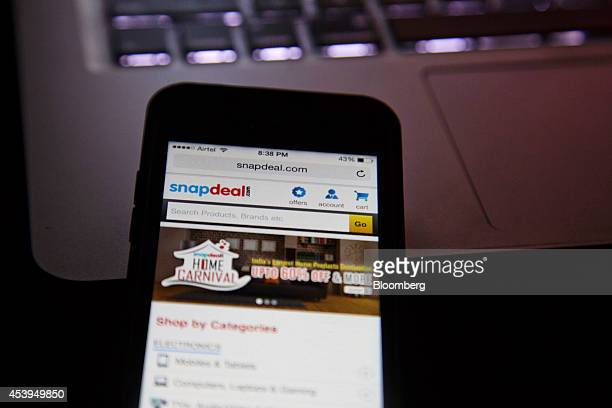 The Snapdealcom website is displayed on an Apple Inc Iphone in an arranged photograph in New Delhi India on Thursday Aug 21 2014 India doesnt allow...
