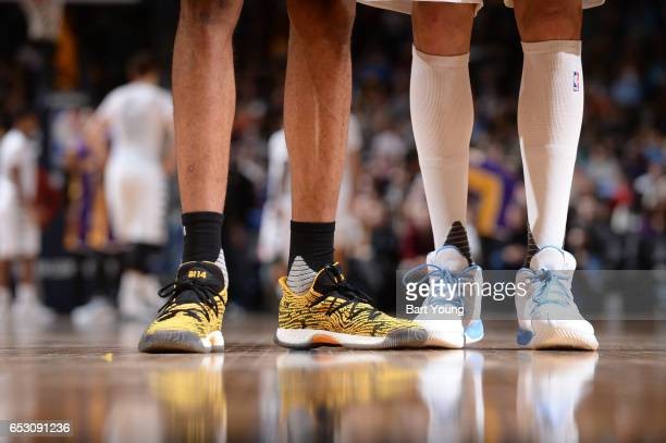 The sneakers of Brandon Ingram of the Los Angeles Lakers and Danilo Gallinari of the Denver Nuggets are seen during a game on March 13 2017 at the...