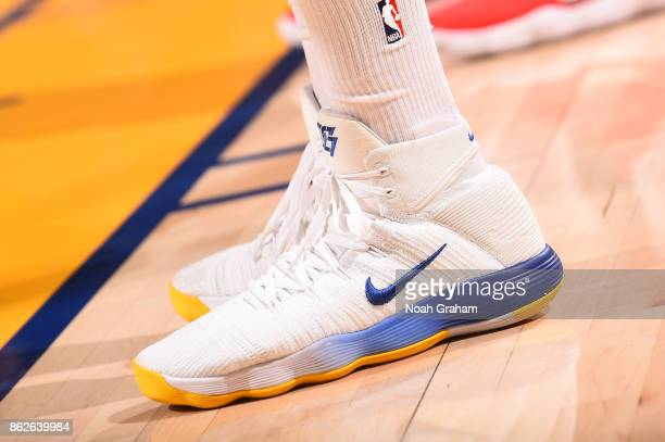 The sneakers of Draymond Green of the Golden State Warriors are seen during the game against the Houston Rockets on October 17 2017 at ORACLE Arena...
