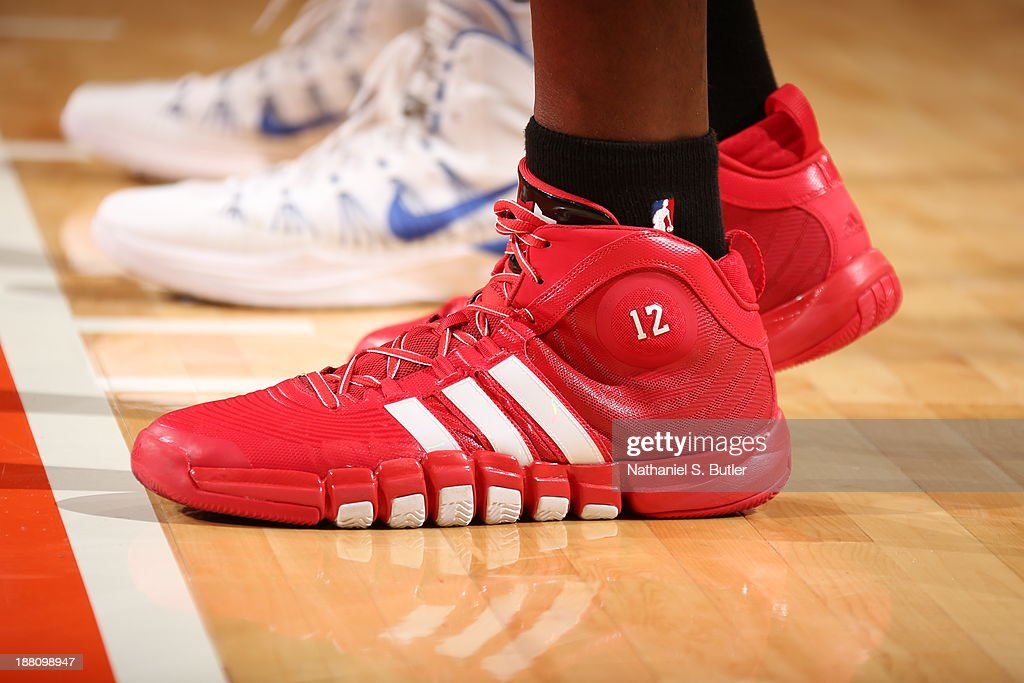 The sneakers of <a gi-track='captionPersonalityLinkClicked' href=/galleries/search?phrase=Dwight+Howard&family=editorial&specificpeople=201570 ng-click='$event.stopPropagation()'>Dwight Howard</a> #12 of the Houston Rockets during a game against the New York Knicks at Madison Square Garden in New York City on November 14, 2013.