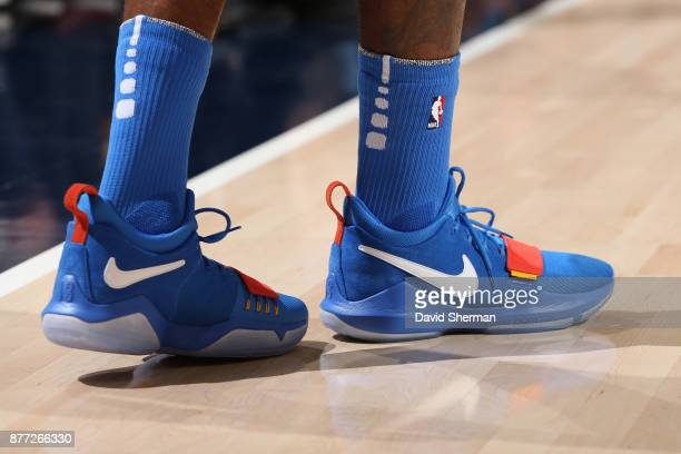 The sneakers of Paul George of the Oklahoma City Thunder are seen during the game against the Utah Jazz on October 21 2017 at Vivint Smart Home Arena...