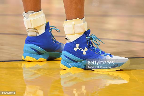 The sneakers of Stephen Curry of the Golden State Warriors during the game against the Cleveland Cavaliers in Game Five of the 2016 NBA Finals on...