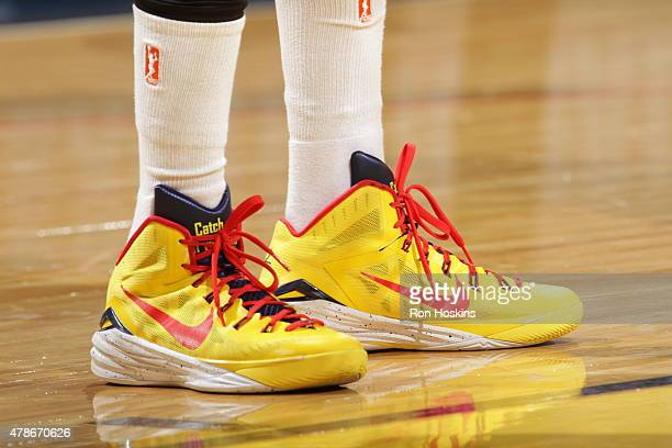 The sneakers of Tamika Catchings of the Indiana Fever are seen during the game against the Chicago Sky on June 26 2015 at Bankers Life Fieldhouse in...