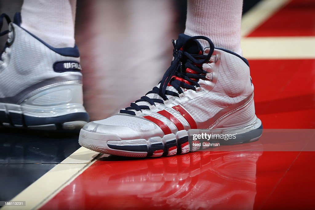 The sneakers worn by <a gi-track='captionPersonalityLinkClicked' href=/galleries/search?phrase=John+Wall&family=editorial&specificpeople=2265812 ng-click='$event.stopPropagation()'>John Wall</a> #2 of the Washington Wizards during the game against the Brooklyn Nets at the Verizon Center on November 8, 2013 in Washington, DC.