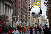The Snoopy ballon floats during the Macy's Thanksgiving Day Parade on November 27 2014 in New York City The annual tradition marks the start of the...