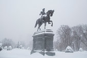 The snow covered George Washington statue in the Boston Public Garden during winter storm Neptune which dropped over a foot of snow February 15 2015...