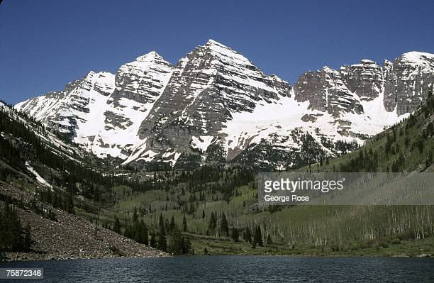 The snow covered peaks of the Maroon Bells located in the White River National Forest are crystal clear in this spring 2003 Maroon Bells Colorado...