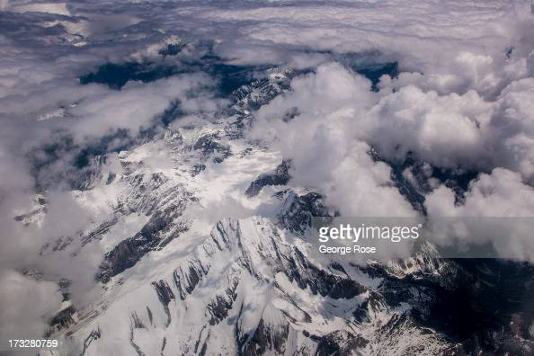 The snowcapped Canadian Rocky Mountains are viewed from 30000 feet on June 24 2013 in Lake Louise Alberta Canada Major flooding along the Bow River...