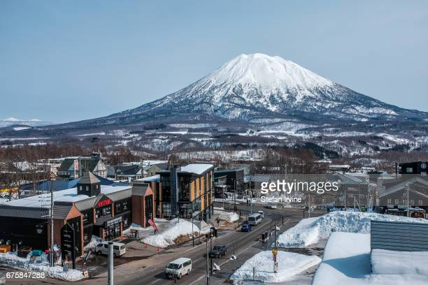 VILLAGE NISEKO HOKKAIDO JAPAN The snowcapped Mount Yotei a dormant volcano in Niseko Japan as viewed in the evening light from the village of Grand...