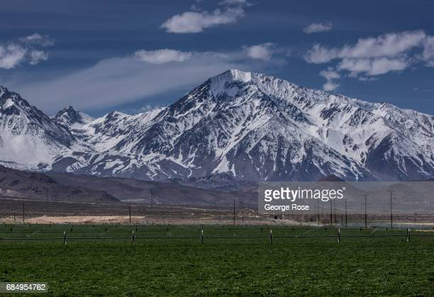 The snowcovered Sierra Nevada Mountains are viewed from Highway 395 at the south end of town on April 6 near Bishop California Owens Valley is an...