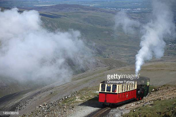 The Snowdon Mountain Railway carries Sir Chris Bonington and the Olympic torch to the summit of Mount Snowdon on May 29 2012 in Llanberis United...