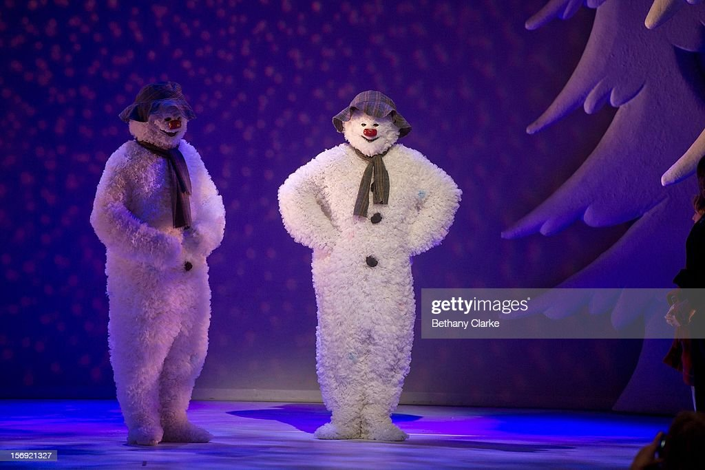 The Snowman and his body double stand on stage at the Peacock Theatre on November 24, 2012 in London, England. The stage show is based on Raymond Briggs 'The Snowman' and will be the 14th year it has been staged by Sadlers Wells.