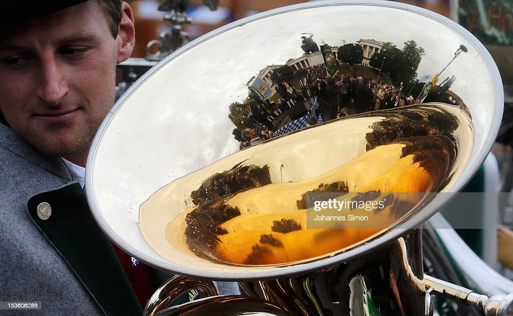 The so called 'Bavaria' giant bronze sculture and landmark of the Oktoberfest is reflected by the trumpet of brass musician during the traditional 'Boellerschiessen' (firing of a salute with a special gun) on the last day of Oktoberfest beer festival on October 7, 2012 in Munich, Germany. The 'Boellerschiessen' officially signifies the closing of this year's edition of the world's biggest beer festival.