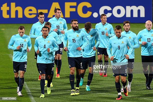 The Socceroos jog a lap of the field while warming up during an Australian Socceroos training session at nib Stadium on August 31 2016 in Perth...