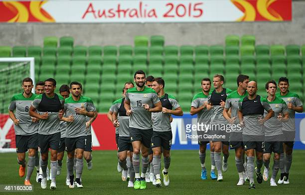 The Socceroos run laps during the Australian Socceroos training session at the Rectangular Stadium on January 8 2015 in Melbourne Australia