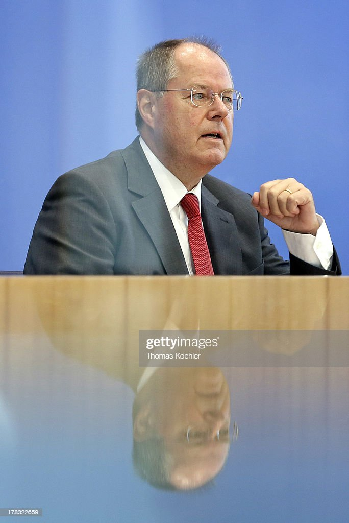 The Social Democratic Party's (SPD) main candidate in upcoming parliamentary elections <a gi-track='captionPersonalityLinkClicked' href=/galleries/search?phrase=Peer+Steinbrueck&family=editorial&specificpeople=209110 ng-click='$event.stopPropagation()'>Peer Steinbrueck</a> speaks during a press conference in Berlin, Germany on August 29, 2013. Steinbrueck laid out his and the party's goal for the first 100 days in government if they were to win the 22nd September parliamentary election..