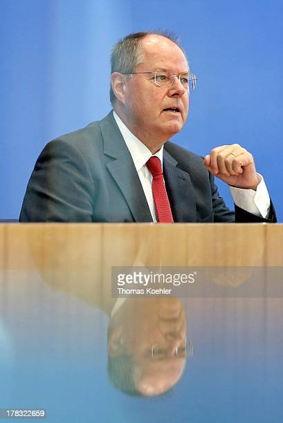 The Social Democratic Party's main candidate in upcoming parliamentary elections Peer Steinbrueck speaks during a press conference in Berlin Germany...
