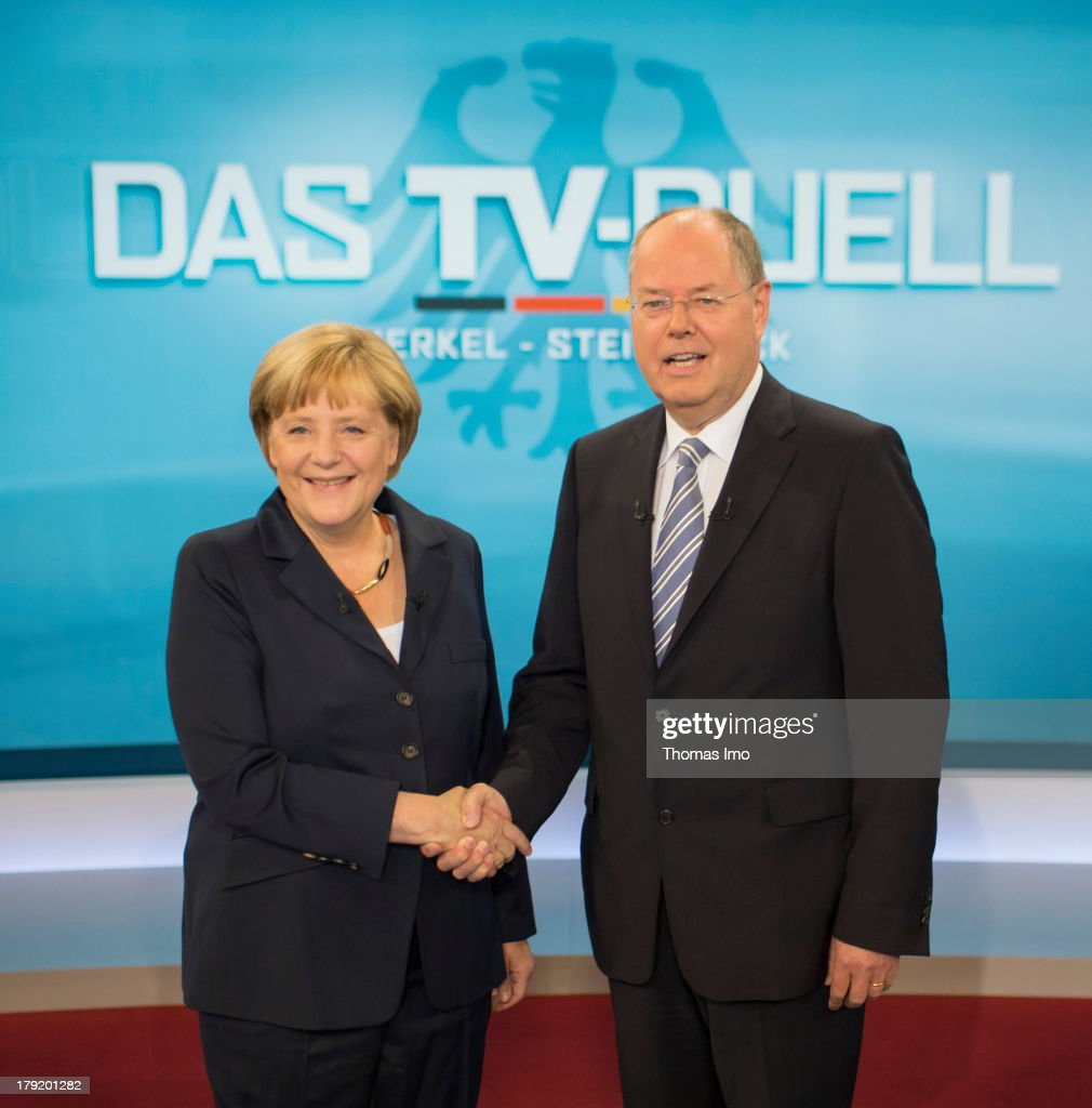 The Social Democratic Party's (SPD) main candidate in upcoming parliamentary elections <a gi-track='captionPersonalityLinkClicked' href=/galleries/search?phrase=Peer+Steinbrueck&family=editorial&specificpeople=209110 ng-click='$event.stopPropagation()'>Peer Steinbrueck</a>, and German Chancellor <a gi-track='captionPersonalityLinkClicked' href=/galleries/search?phrase=Angela+Merkel&family=editorial&specificpeople=202161 ng-click='$event.stopPropagation()'>Angela Merkel</a> pose for a photograph before their TV Debate on September 01, 2013 in Berlin, Germany. Germany is scheduled to hold federal elections on September 22 and Merkel's Christian Democrats (CDU) is so far maintaining a generous lead over its main rival in polls.