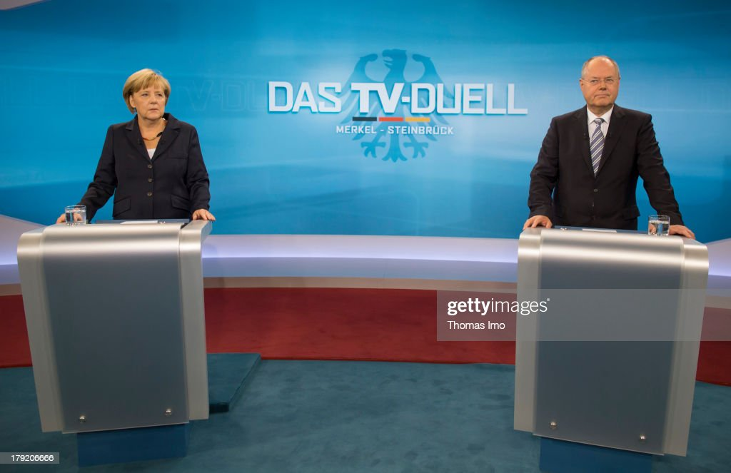 The Social Democratic Party's (SPD) main candidate in upcoming parliamentary elections <a gi-track='captionPersonalityLinkClicked' href=/galleries/search?phrase=Peer+Steinbrueck&family=editorial&specificpeople=209110 ng-click='$event.stopPropagation()'>Peer Steinbrueck</a>, and German Chancellor <a gi-track='captionPersonalityLinkClicked' href=/galleries/search?phrase=Angela+Merkel&family=editorial&specificpeople=202161 ng-click='$event.stopPropagation()'>Angela Merkel</a> poses for a photograph before their TV Debate on September 01, 2013 in Berlin, Germany. Today's live debate is the only one between the two candidates ahead of German elections scheduled for September 22. Merkel's Christian Democrats (CDU) is so far maintaining a generous lead over its main rival in polls.